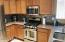 Kitchen with Stainless Steel Range, Oven & Built-in Microwave