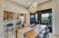 Dining room opens to kitchen with breakfast bar.
