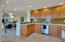 Roomy kitchen with granite counters and ample storage.