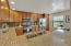 Granite counters, stainless steel appliances and pull-out shelving pantry.