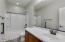 Hallway bathroom with tub shower