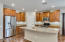 Spacious Kitchen Island with staggered cabinets & Stainless Steel Appliances