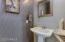 Powder room with designer wallpaper and pedestal sink
