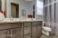 Hallway bathroom with double sinks