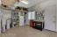 Workspace in the garage with raised storage racks