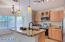 Beautiful open kitchen slab granite and under-mount sink.