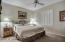 Guest bedroom w/ plantation shutters