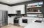 Gas range, farmhouse sink, newer appliances, full wall length tile, floating shelves, plenty of storage.