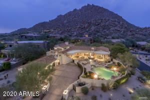Custom estate with surrounding mountain views and twinkling city lights.