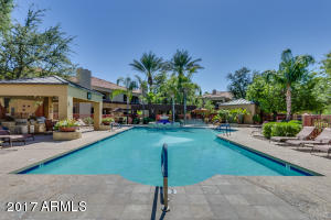 Resort style living in Scottsdale! Idle by the resort style HEATED Pool w/ ramada & Sunken Spa, Gas Grills, Business Center w/ Internet Access, Fitness Center, Steam Room, Billiards, Lounge & 8 person Theatre Room. This upper level condo includes open layout, tile entry way, all appliances, full size washer & dryer, spacious walk in closet & a covered balcony. This floor plan designed with comfort & convenience in mind. Highly desired Scottsdale location close to everything, including great nightlife, golf, tons of dining & shopping choices, & award-winning Scottsdale schools. This condo is currently tenant occupied and is month-to-month. Perfect for a first time home buyer, second home or investment. On site property management available. This will go quick - don't miss this one!