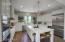 Highly upgraded with Wolf double ovens, range and Subzero refrigerator