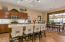 Kitchen with large center island and dining room
