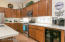 Kitchen with stainless appliances and wine refrigerator