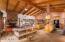 Open floorplan, beamed ceiling, fireplace