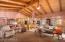 Lodge-like great room, open floorplan, ceiling fans,