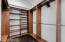 additional walk in closet in master bedroom with skylights