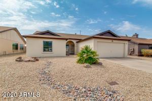 Front of home- Easy care desert landscaping.