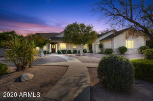 This North Estate is perfect! 5 beds, office, basement, pool, 3/4 acre lot, 30+ citrus trees.