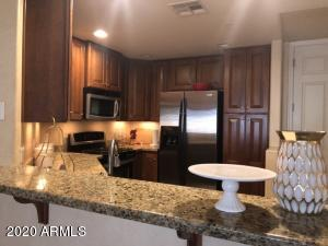 Beautiful condo in premier resort community with 24/hr guard gate access, heated pools, state of the art fitness room, onsite concierge, tennis courts, elevators, community events. Luxury Living!  Granite countertops and stainless steel appliances in kitchen. Built in entertainment center, custom paint, wooden shutters in living room. Close to Mayo Clinic, Kierland Commons, Desert Ridge,  21 miles from Sky Harbor Airport.  Nearby area with upscale shopping,  restaurants and golf courses. Must see!!!