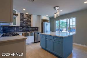 remodeled modern kitchen with island white soft -close shaker cabinets