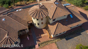The large rotunda, inspired by Portuguese architecture, anchors the exotic feel of the home.