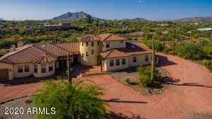 Elegant residence in Cave Creek with Black Mountain in the background. The signature rotunda leads to an amazing upstairs secret suite. Main living areas are all on one level on the bottom. Nice area available for equestrian use as well!