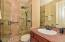 Renovated downstairs bath with tile surround shower and frameless glass