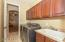 With extra storage cabinets and sink