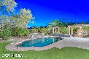 This home is a homeowner's dream backyard. Synthetic Grass, Private Pool w/ Water Feature, Spa, Pergola, Gas Fireplace, & Built-in BBQ
