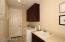 SPACIOUS LAUNDRY ROOM W/ SINK AND TONS OF CABINETS! (WASHER & DRYER INCL)