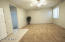 Lots of room for a movie room/ pool table or play area.