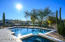 Did you notice the travertine paver patio surrounding the custom designed pool & spa?