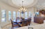 complete with a Circular Coffered Ceiling and Custom Lighting.