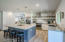 BEAUTIFUL KITCHEN WITH OPEN SHELVING AND BIG ISLAND