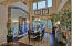 Soffit Ceiling, Stone Veneer Trim, Chandelier w/Matching Wall Sconces and Wood Flooring