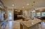 Abundance of Granite Countertops and Work Space
