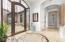 Gorgeous custom metal front door, domed ceiling and floor medallion