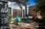 Relax on your shaded front porch in this quiet gated community.