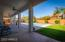 Extended covered patio with fans and surround sound speakers.