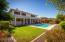 This backyard has it all! Ramada, pool, outdoor kitchen and grass area.