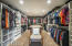 Ample Master closet with custom cabinetry.