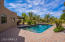 Large pebble surface diving pool with a beach entry.
