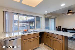 Nice size kitchen, notice those brand new windows!