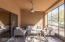 The calming, screened Arizona room overlooks the patio and desert area.