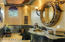 Black galaxy granite tops with copper glass coated basin, and barrel ceiling