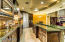 Custom Kitchen Cabinetry with rope finishes, 4 dishwashers, furniture style built in hutch