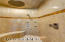 Circular shower with 8 body spray jets and rain shower along with steam bath shower