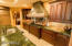 Madagascar Victoria Grieggia granite counter tops, Cantera chimney exhaust painted in Venetian plaster.