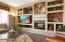 Great Room with built-in media niche and gas fireplace