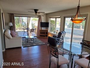One of a kind home in Fountain of the Sun! This end unit townhome style condo is special! It is very light and bright with two bay windows and sliding glass with golf course view! No other unit in the area has this! Offered fully furnished as you see it, including refrigerator, washer/dryer, water softener and BBQ grill. Spilt bedroom plan. Large master with sliding glass door to patio, walk-in, large bath vanity. Beautiful laminate flooring in living areas & guest bedroom. Tile in kitchen & baths, carpet in master bedroom. Upgraded light fixtures & fans. Upgraded hall bath vanity. Built-in desk in guest bedroom. 55+ community is guard gated with 24hr security. Lakes, golf course, planned activities, pickle ball, yoga, arts & crafts, billiards, card room, shuffleboard and more! NO PET AREA